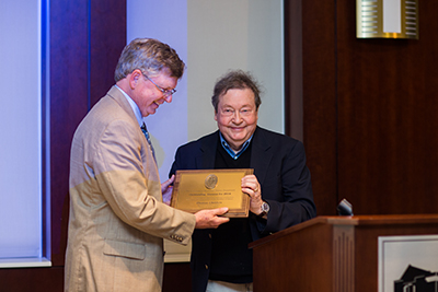 Robert Norrell (left) presents award to Tom Childers.